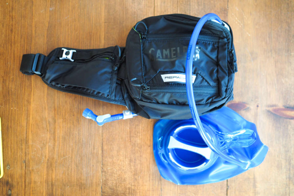 CamelBak Repack fanny pack from the top showing the water reservoir and straw