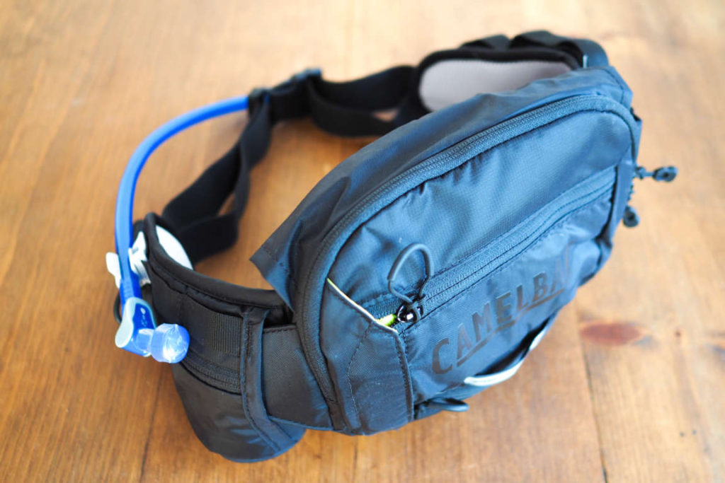 CamelBak Repack fanny pack from the side showing the mouthpiece