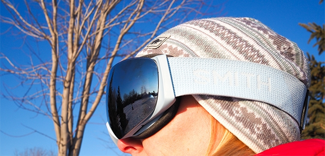 woman wearing Smith I/O Mag Snow Goggles with blue strap