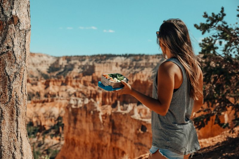 girl hiking with reusable lunch box